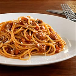 Barilla Whole Grain Spaghetti with Tuscan Sauce Recipe - This traditional Italian spaghetti dish from Tuscany is a delicious combination of ground beef, pork, San Marzano tomatoes, and fresh herbs in a red wine sauce.