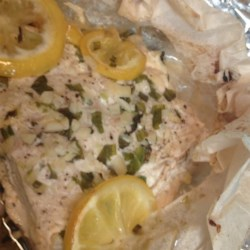 Citrus-Herbed Baked Salmon Recipe - Using the sealed-pouch method, these salmon fillets are kept moist and tasty by cooking with lemon, onion, dill, and basil.