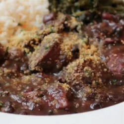 Chef John's Brazilian Feijoada Recipe - This traditional Brazilian bean stew is cooked with lots of smoked meats for a rich, hearty meal. Serve with white rice and greens.