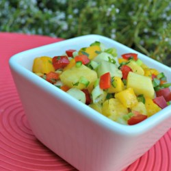 Pineapple Mango Chutney Recipe - This sweet and spicy chutney combines pineapple, mango, cucumber, and jalapeno for a colorful topping for scallops or chicken.