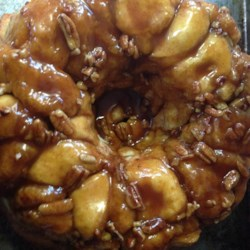 Amazing Monkey Bread Recipe - Frozen bread dough rises overnight with a sweet and sticky blend of butterscotch pudding mix, sugar, and cinnamon. Chopped pecans add a terrific crunch to this popular brunch bread.