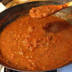 Homemade Spaghetti Sauce Recipe - Peeled, ground tomatoes are slowly simmered with onion, garlic, basil, red wine and Italian seasoning to make a rich, traditional sauce.
