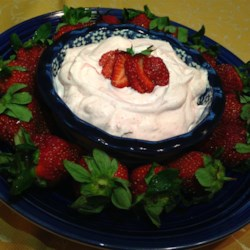 Creamy Strawberry Fruit Dip Recipe - This lovely combination of strawberry yogurt, strawberry gelatin, and whipped topping makes a delightfully delicious dip for fresh fruit.