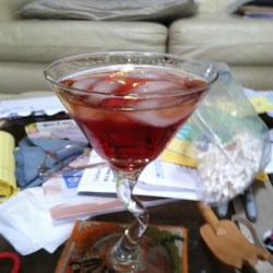 Cosmopolitan Martini Recipe - This is a great drink for folks who like the presentation of a martini, but can't stomach the strong alcohol taste. The cranberry juice takes the bite right out of this drink and gives it a smooth taste.