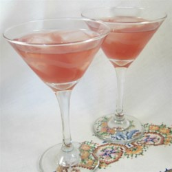Cranberry Kamikaze Recipe - Orange-flavored liqueur, lime and cranberry team up with vodka for a sweet-and-sour drink that 's on the pink side!