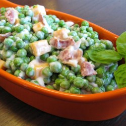 Bacon Pea Salad Recipe - Bacon and fresh peas are tossed in a creamy dressing creating a lovely summer salad to bring to picnics.