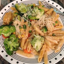 Penne Primavera Recipe - Sauteed broccoli, carrots, and peas serve as the summertime toppings for penne pasta.