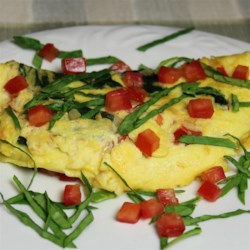 Florentine Eggs Recipe - Eggs cooked with spinach, mushrooms, tomatoes, and mozzarella cheese are a Florentine-inspired breakfast item.
