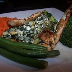 Cajun chicken with spinach ricotta and pinenuts