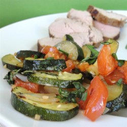 Roasted Garlic Zucchini and Tomatoes Recipe - A little sprinkle of Parmesan cheese and a touch of fresh basil take this garden fresh zucchini and tomato dish to a new level.