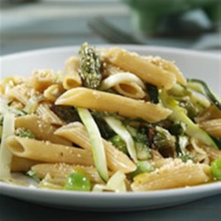 Barilla(R) PLUS(R) Penne with Walnuts, Lemon, Spring Greens and Herbs Recipe - Penne is tossed with lightly-sauteed new spring vegetables, fresh herbs, and walnut lemon bread crumbs.