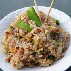 Fried Rice II Recipe - Fried rice is best made with rice that's been refrigerated, so it's a great way to use leftover rice. In this reicpe rice is stir fried with snow peas, onions, bean sprouts, eggs and soy sauce.