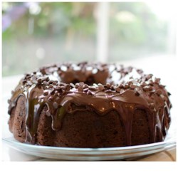 Too Much Chocolate Cake Recipe and Video - Start with a box of chocolate cake mix and add a few ingredients like sour cream and chocolate chips to make a moist, intensely-flavored chocolate cake that will win you First Prize from your friends and family.