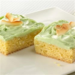 Key Lime Coconut Bars Recipe - Life's a beach with luscious Duncan Hines Lemon cake mix, flakey coconut and Key Lime frosting creations. Cue the marimbas!