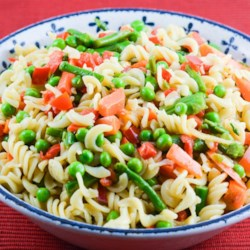 Pasta Salad I Recipe - This colorful pasta salad features a medley of crunchy veggies! Combine pasta with broccoli, cauliflower, carrots, celery, bell peppers, mushrooms and fiery sweet red onions. A sweetened mayonnaise and vinegar binds the salad.