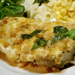 Barramundi With Lemon Basil Sauce Recipe - Barramundi, also known as Asian sea bass, is topped with a lemon-butter-basil sauce for a flavorful main dish for dinner parties.