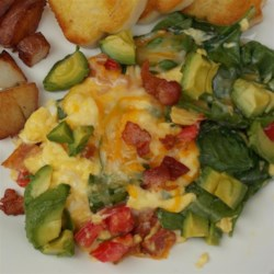 BLT Eggs Recipe - Scrambled eggs with bacon, tomato, avocado, and spinach also known as 'BLT eggs' are a creative way to enjoy the pleasures of the classic sandwich.
