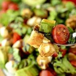 Southwest Summer Salad Recipe - Rice, chicken, avocado, and tomato are tossed in a jalapeno dressing creating a refreshing Southwest-inspired salad perfect for hot weather.