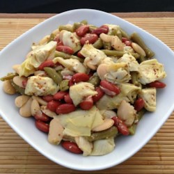 Three Bean and Artichoke Salad Recipe - Green beans, red kidney and butter beans join forces with artichoke hearts in this salad that works as well for a summer picnic as for a winter evening 's dinner. A nice coarse ground mustard, lemon juice and oil dressing is stirred in.