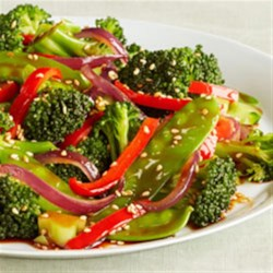 Sesame Vegetable Stir-Fry Recipe - Broccoli, snow peas, red onion, and bell pepper are stir-fried in sesame oil and seasoned with soy sauce and sesame seeds.