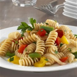 Barilla PLUS(R) Rotini with Three Peppers and Herbs Recipe - Rotini pasta is tossed with sauteed red, green, and yellow bell peppers, and lightly seasoned with thyme and parsley.