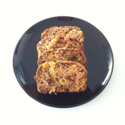 Magic Mango Bread Recipe - Bake yourself into a tropical paradise! Mango, coconut and raisins make this an irresistible quick bread.