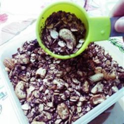 Double Chocolate Granola Recipe - Cocoa powder and chocolate chips deliver a double dose of chocolate to this homemade granola recipe with cashews and mixed dried fruit.