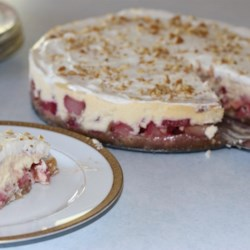 Rhubarb Cheesecake Recipe - An exquisite cheesecake made with fresh rhubarb and finished with sour cream topping.