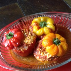 Slow Cooker Stuffed Peppers Recipe - Bell peppers stuffed with ground beef, rice, and tomatoes can be made in the slow cooker for an easy weeknight meal.