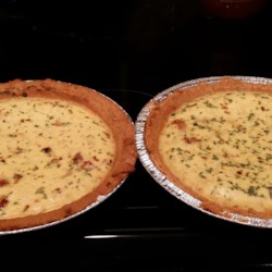New Quiche Lorraine Recipe - Traditional quiche Lorraine is baked into a rich, custard-like texture thanks to the addition of sour cream to the recipe.
