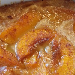 California Peach Cobbler Recipe - Tender and juicy peaches are baked on top of a buttery batter creating a rich peach cobbler everyone will remember.