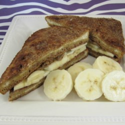 Vanilla Banana French Toast Recipe - A French toast sandwich filled with bananas and cinnamony eggs.