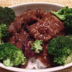 Crispy Orange Beef Recipe - A delicious crispy and sweet, yet  mildly spiced beef stir-fry recipe served with steamed rice and broccoli.