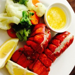Lobster Tails Steamed in Beer Recipe - Steamed lobster tails with a hint of beer. Goes great with melted butter, lemon juice and garlic.