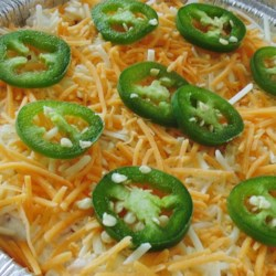 Cheesy Jalapeno Dip Recipe - This cheesy and creamy baked dip recipe uses canned and fresh jalapeno peppers to bring the heat for an item that can double as an ideal bacon-cheeseburger spread.