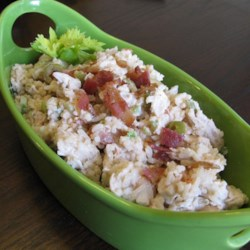 Lemon BBQ Chicken Salad Recipe - Leftover chicken and rice are elevated into a delicious summertime salad thanks to lemon juice, olives, bacon, and barbeque sauce in this salad recipe.