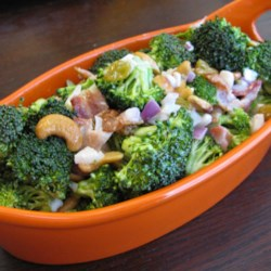 Broccoli-and-Bacon Salad Recipe - Broccoli and bacon, of course, but also raisins and cashews in a salad dressed with a creamy mayonnaise-based dressing.