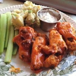 Baked Buffalo Wings Recipe - These easy to make hot wings are crispy without being fried. You can add more cayenne or use a higher hot sauce to butter ratio if you like them spicier!