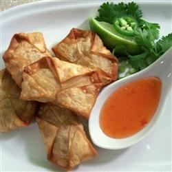 Spicy Chicken and Cilantro Wontons Recipe - These crispy appetizers are a favorite in my family. The flavorsome herbs in this recipe, as well as the chile, give the wontons a nice kick.