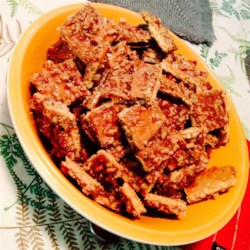 Praline Strips Recipe - A buttery brown-sugar pecan sauce is poured over graham crackers creating sweet praline strips.