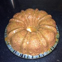 Gluten-Free Caramel Apple Cake Recipe - Gluten-free apple cake with flax seed is topped with a homemade caramel sauce creating a moist and delicious dessert the whole family will love.