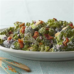 Broccoli Salad from VOSKOS(R) Recipe - A few flavorful additions and ingredient swaps change up the basic broccoli-raisin salad. This version takes the fresh side dish into the healthful realm with added dried blueberries and almonds. VOSKOS(R) Nonfat Blueberry Greek Yogurt replaces the mayo.