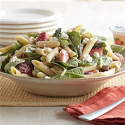 Strawberry-Asparagus Pasta Salad Recipe - Tangy white balsamic vinegar contrasts with VOSKOS(R) Nonfat Strawberry Greek Yogurt for a creamy dressing on this vibrant side salad featuring strawberries, asparagus, spinach, and pasta. Serve with roast chicken or grilled steak.