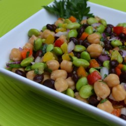 Edamame Fresca Recipe - This refreshing and colorful edamame salad has black beans, garbanzo beans, red and yellow bell peppers and is tossed in a light rice vinegar dressing.