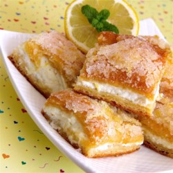Lemon Cream Cheese Bars Recipe - Lemon cream cheese bars are a variation of the traditional lemon bars, made with crescent roll dough and a lemony cream cheese filling.
