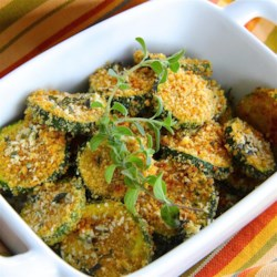 Baked Zucchini Chips Recipe - Baked zucchini chips coated in bread crumbs and Parmesan cheese are a tasty alternative to fries and potato chips.