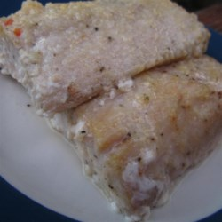 Lemon Pepper Mahi Mahi Recipe - Baked mahi mahi that has marinated in a lemon-pepper Italian dressing is a tangy and savory way to enjoy fish. Serve with your favorite sides.