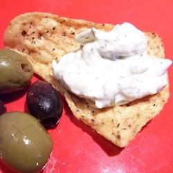 Tzatziki II Recipe - A Greek dip with a pungent garlic flavor. Good served with hot pita bread triangles. Chill for at least 30 minutes before serving to develop the flavor. If you prefer, use parsley in place of the mint.