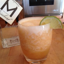 Cantaloupe Fizz Recipe - A delicious blended ice drink of cantaloupe and gin. This made me one BIG all night drink but divide into 2 or 4 as desired.  Of course you can adjust everything to your liking and blender size. Make sure to use the juiciest and ripest fruit you can get.