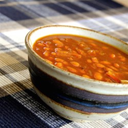 Skillet Baked Beans Recipe - Doctor canned pork and beans by adding crispy bacon, onion, sugar, molasses, and mustard for a quick and easy barbeque side dish.